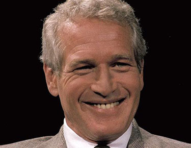 """Paul Newman...** FILE **In this 1978 file photo, actor and U.N. ambassador to disarmament Paul Newman is seen. Newman, the Academy-Award winning superstar who personified cool as an activist, race car driver, popcorn impresario and the anti-hero of such films as """"Hud,"""" """"Cool Hand Luke"""" and """"The Color of Money,"""" has died, a spokeswoman said Saturday. He was 83. Newman died Friday, Sept. 26, 2008, of cancer, spokeswoman Marni Tomljanovic said. (AP Photo)"""