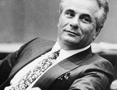 Reputed Gambino family crime boss John Gotti leans back during a break in testimony in New York Supreme Court in Manhattan, Jan. 23, 1990.  Gotti and a co-defendant are charged with conspiracy and assault in connection with a shooting of a carpenter's union leader.  (AP Photo/Daniel Sheehan)